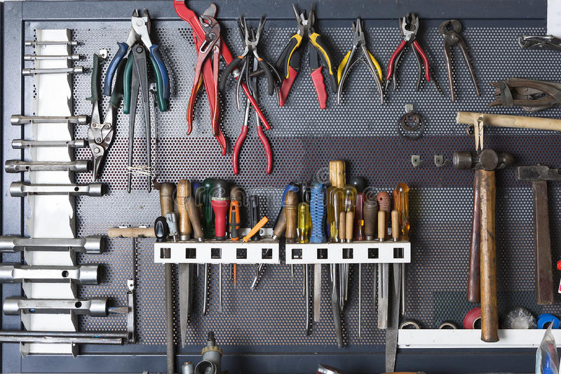 Tools on a metal board royalty free stock photography