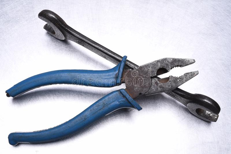 Tools on metal table wrench, pliers stock photography