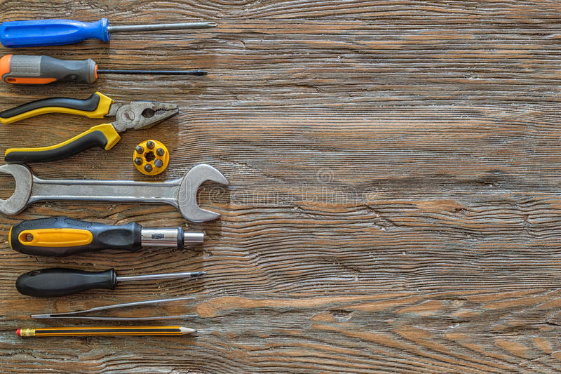 Tools on an old wooden background with copy space stock photography