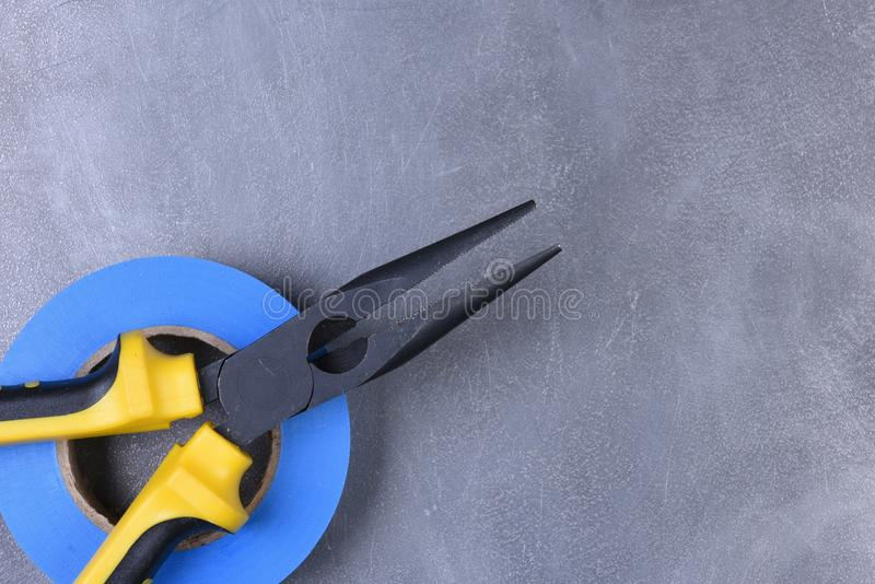 Tools pliers and tape on metal background royalty free stock photos