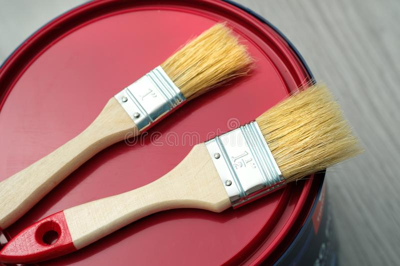 House renovation, paint can on the old wooden background with copy space royalty free stock photography