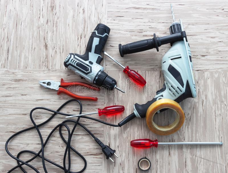 Tools for repair, screwdriver, electric drill, electro-screwdriver, electrical tape stock photos