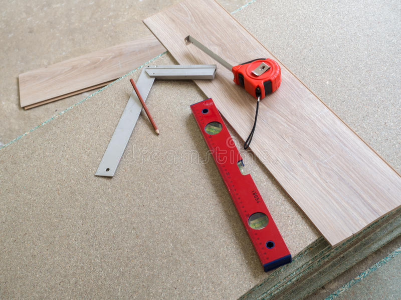 Tools. Repairing apartment& x27;s floor . Plates of pressed wood chips. Laminate. Measuring the Tools, building level, tape measure stock images