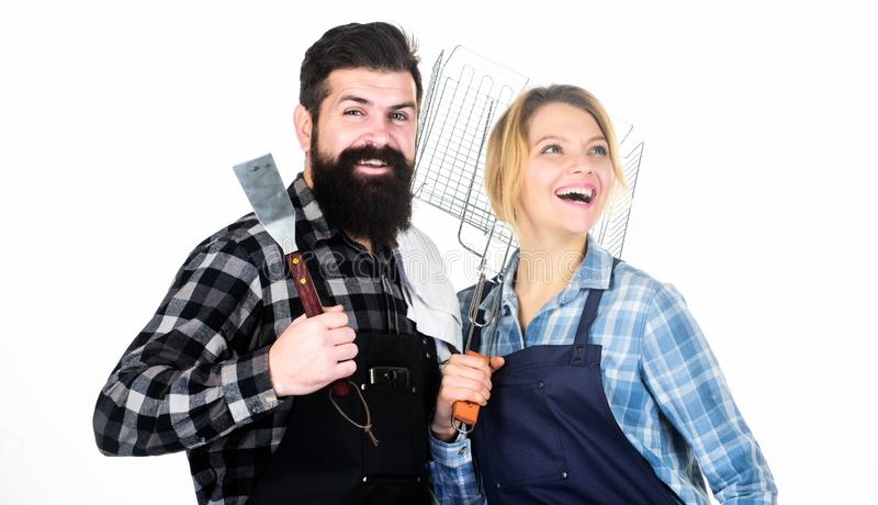 Tools for roasting meat. Couple in love hold kitchen utensils. Man bearded hipster and girl. Preparation and culinary stock photo