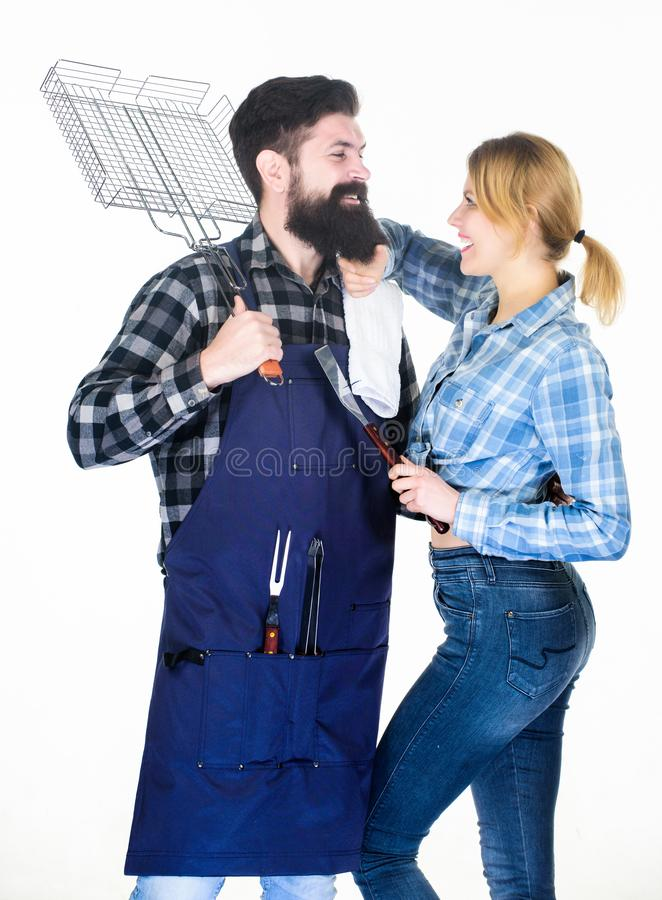 Tools for roasting meat. Family weekend. Man bearded hipster and girl. Preparation and culinary. Couple in love hold royalty free stock photos