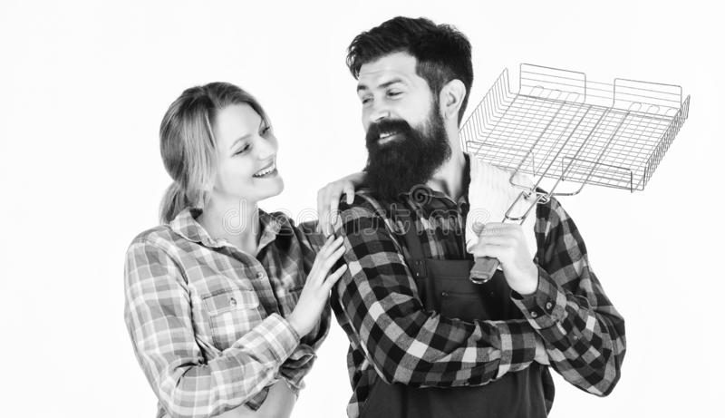 Tools for roasting meat. Man bearded hipster and girl. Preparation and culinary. Family weekend. Couple in love hold stock photo