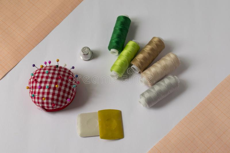 ..tools for sewing and needlework. hobby. multi-colored sewing thread royalty free stock photo
