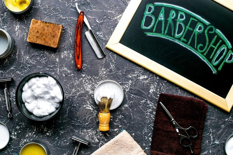 Tools for shaving in barbershop on workplace background top view. Tools for shaving beard in barbershop for men on white workplace background top view royalty free stock images