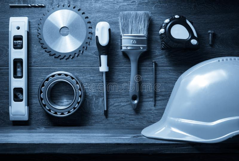 Tools and shelf at brown background. Tools and wooden shelf at brown background stock photo