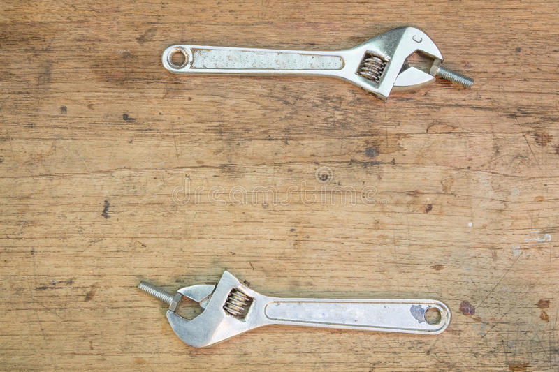 Tools supplies on a wooden background, wrench royalty free stock image