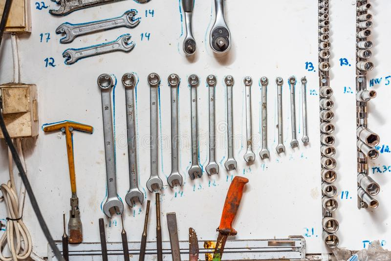 Tools systematically arranged on a wall stock image