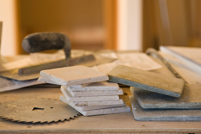 Tools and tile work royalty free stock photography