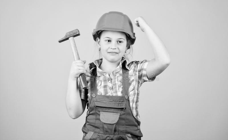Tools to improve yourself. Child care development. Builder engineer architect. Future profession. Kid builder girl. Build your future yourself. Initiative royalty free stock photos