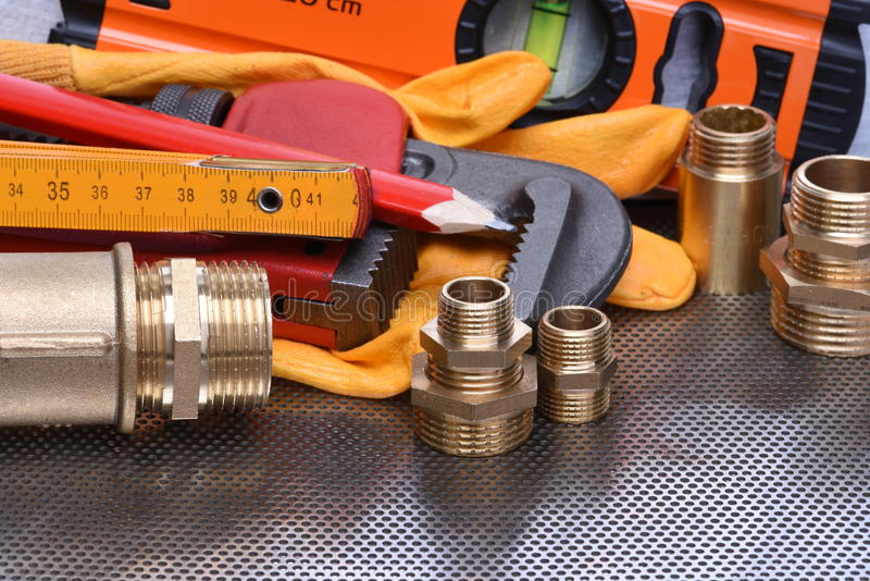 Tools to work on heating systems and plumbing. On metal background royalty free stock images
