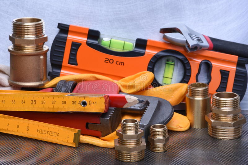 Tools to work on heating systems and plumbing. On metal background stock photo