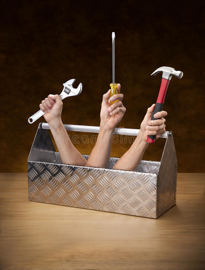Tools Toolbox Toolkit Business. A conceptual image of a toolbox with hands holding a wrench, screwdriver and hammer coming out. Can be paired with a similar