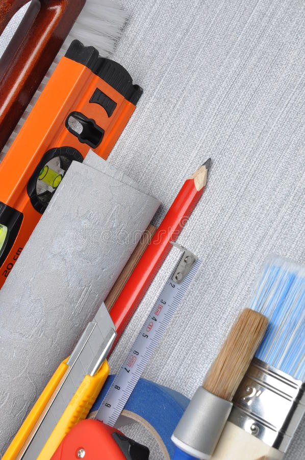 Tools used for wallpapering, renovation. And repair at home stock image