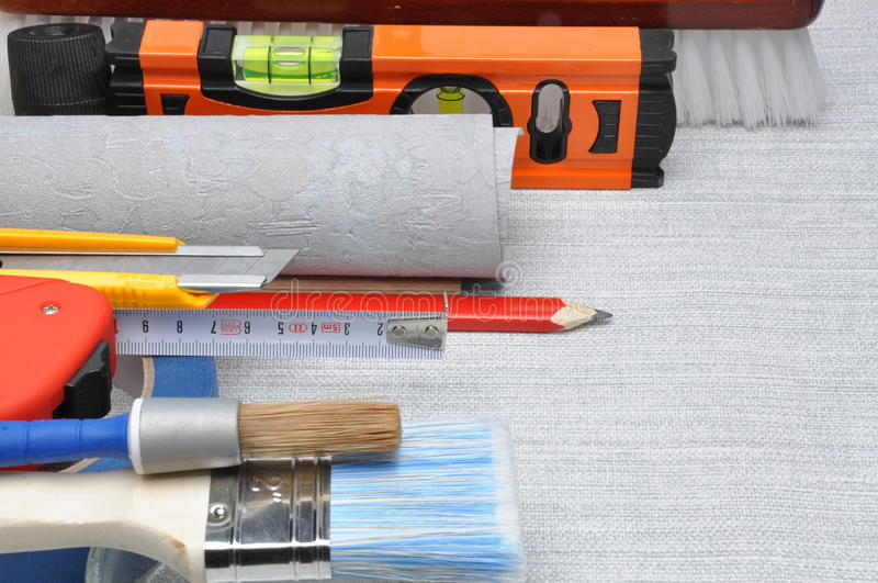 Tools used for wallpapering, renovation. And repair at home stock photo