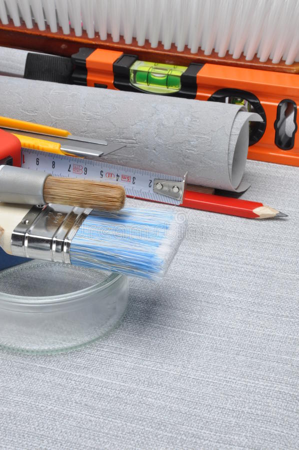 Tools used for wallpapering, renovation. And repair at home stock photography