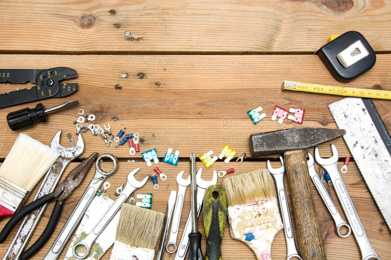 Tools on wood. Many tools on a wood table royalty free stock photos
