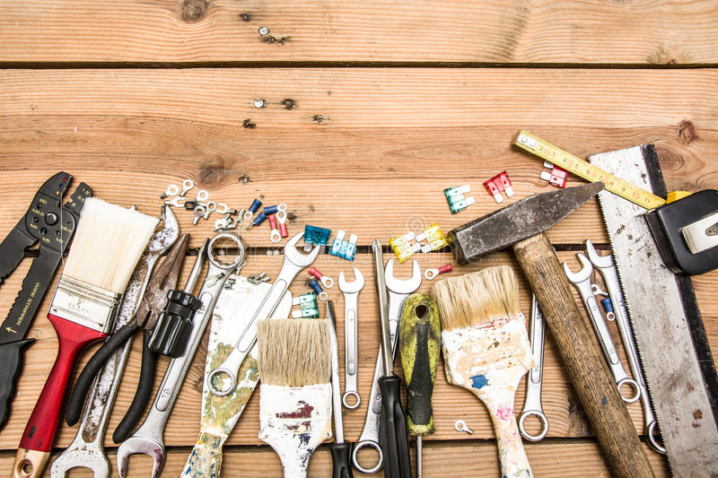 Tools on wood. Many tools on a wood table stock photography