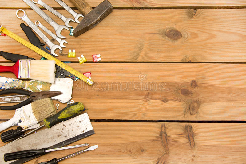 Tools on wood. Many tools on a wood table stock photo