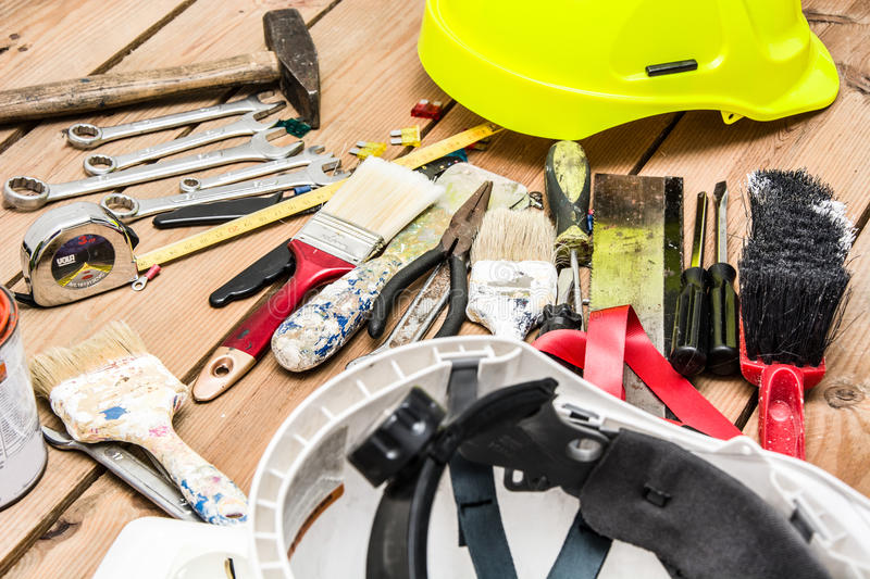Tools on wood. Many tools on a wood table royalty free stock photography