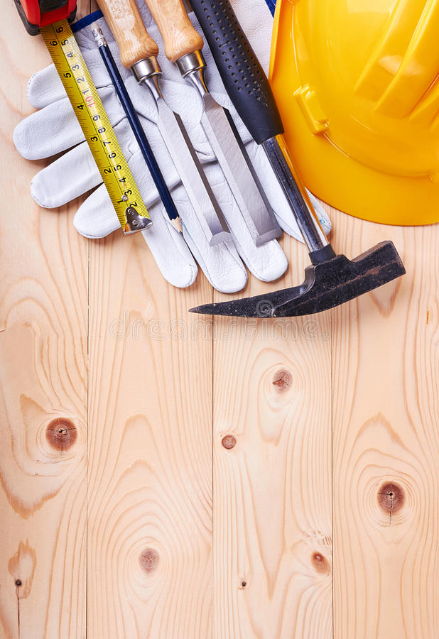 Tools on a wooden background royalty free stock photos