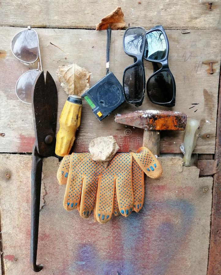 Tools on wooden background - hammer, screwdriver, metal shears, gloves royalty free stock images