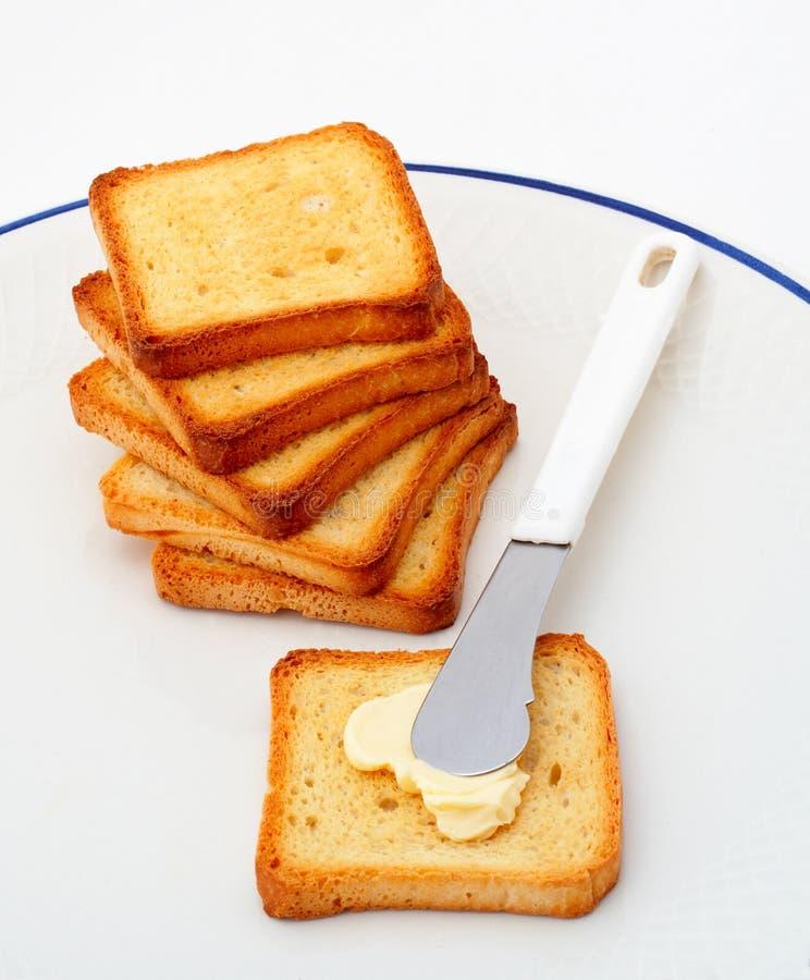 Toost met boter stock foto's