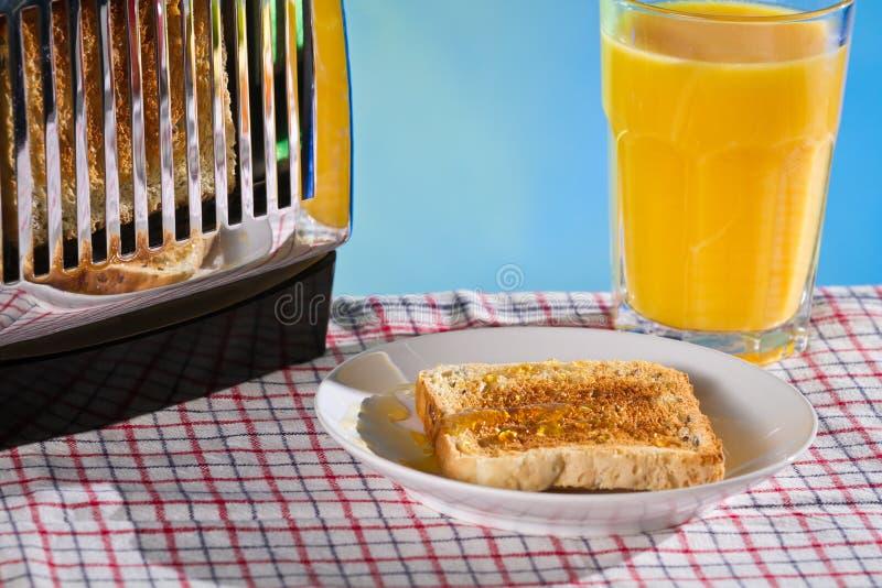 Toost met honing en vers jus d'orange royalty-vrije stock afbeelding