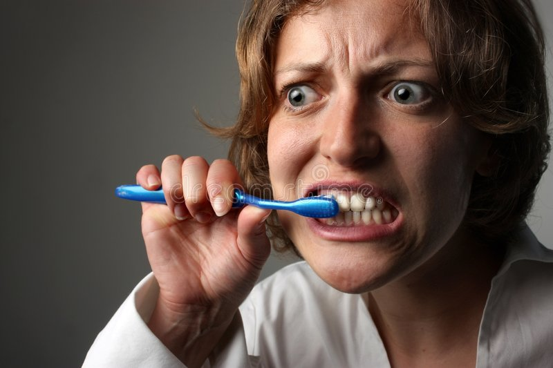 Tooth. A woman with tooth brush stock photography