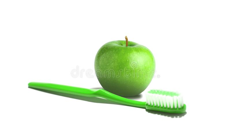 Tooth brush and apple royalty free stock photography