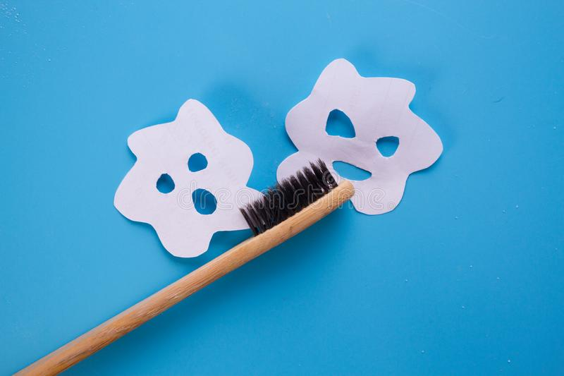 Tooth brush on blue background. With bacteria on it stock photography