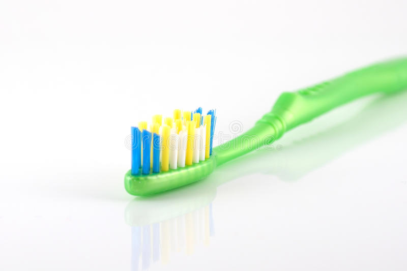 Tooth-brush With Green Handle Royalty Free Stock Photos