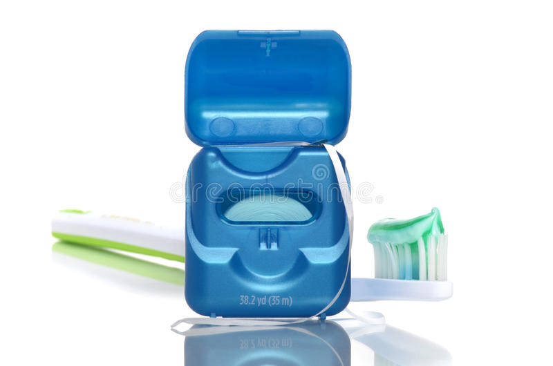 Tooth Care. Floss and toothbrush with toothpaste gel isolated on white background royalty free stock image