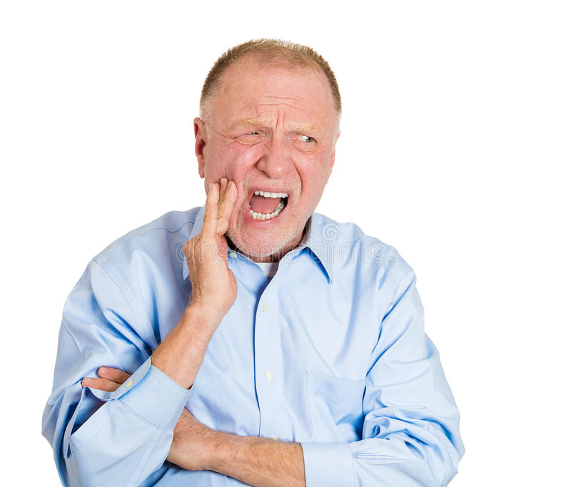 Tooth pain. Closeup portrait elderly business man with tooth ache crown problem cavity crying from pain touching outside mouth with hand isolated white royalty free stock photography