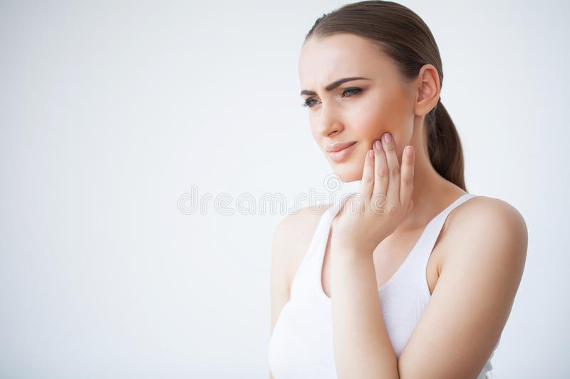Tooth Pain. Dental care and toothache. Woman Feeling Tooth Pain. Closeup Of Beautiful Sad Girl Suffering From Strong Tooth Pain. Attractive Female Feeling royalty free stock photo