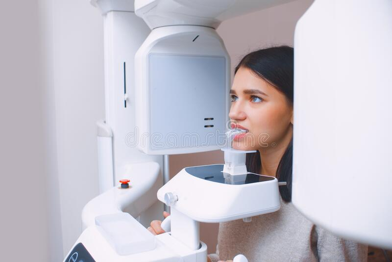 Tooth x-ray in the dental office. Young girl at the dentist`s appointment.  stock image