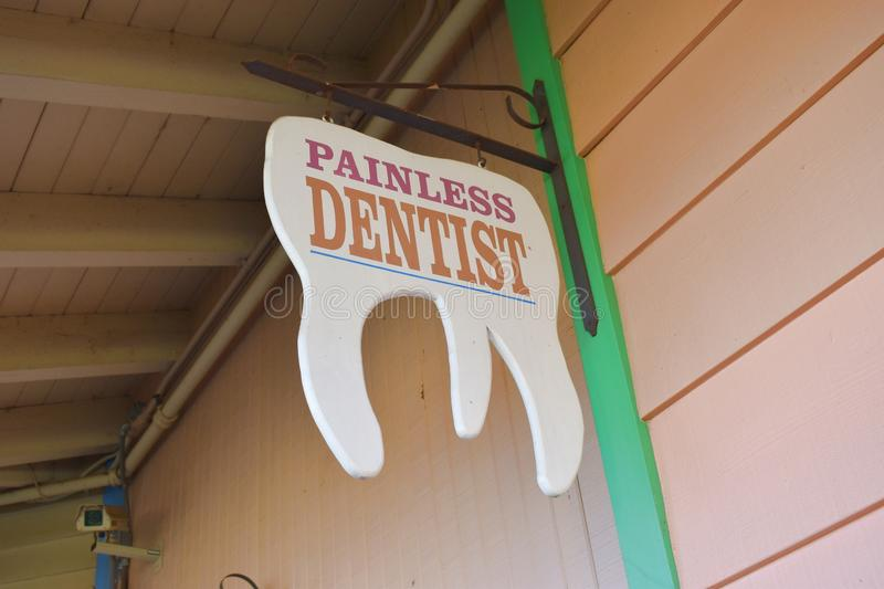 Old timey dentist sign from the wild west stock photo