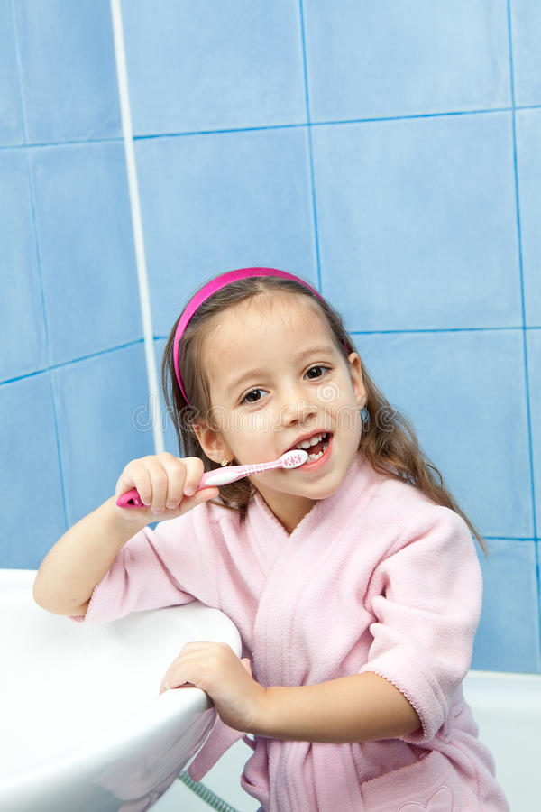 Download Tooth Washing - Little Girl In Bathroom Stock Image - Image: 22487877