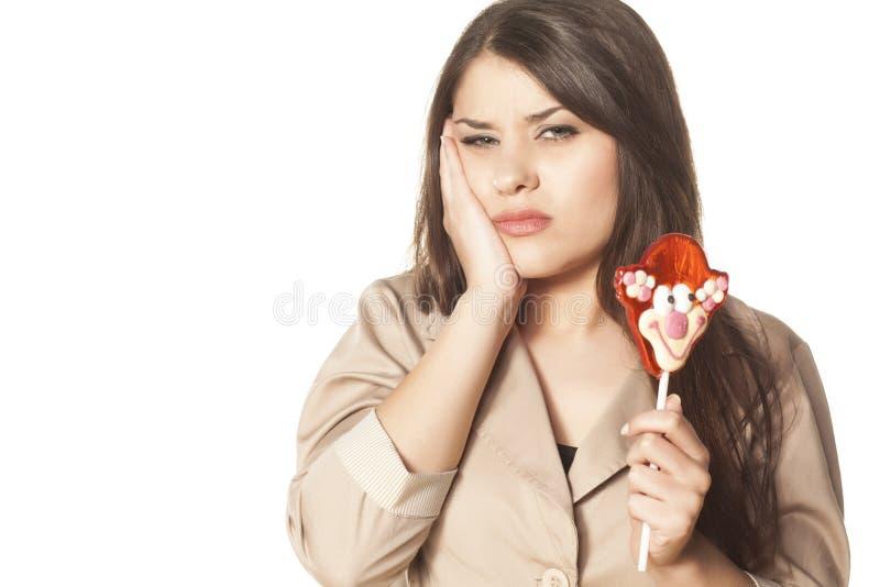 Toothache от леденца на палочке стоковое фото