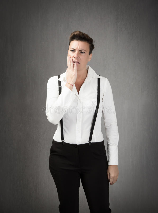 Toothache problems. Business woman emotion and expression royalty free stock images