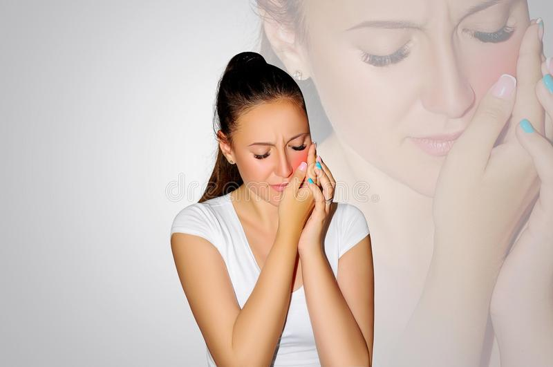 Toothache. Teeth problem. Woman feeling tooth pain. Closeup of beautiful sad girl suffering from strong tooth pain. Attractive fem. Ale feeling painful toothache stock photo