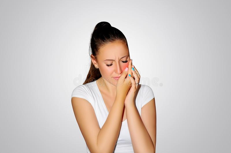 Toothache. Teeth problem. Woman feeling tooth pain. Closeup of beautiful sad girl suffering from strong tooth pain. Attractive fem. Ale feeling painful toothache royalty free stock image