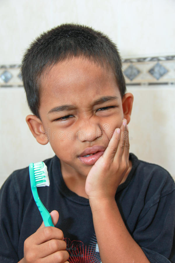 Download Toothache Vs. Tooth Brushing Stock Photo - Image: 24075648