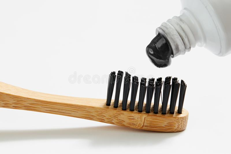 Toothbrush with black charcoal toothpaste royalty free stock images