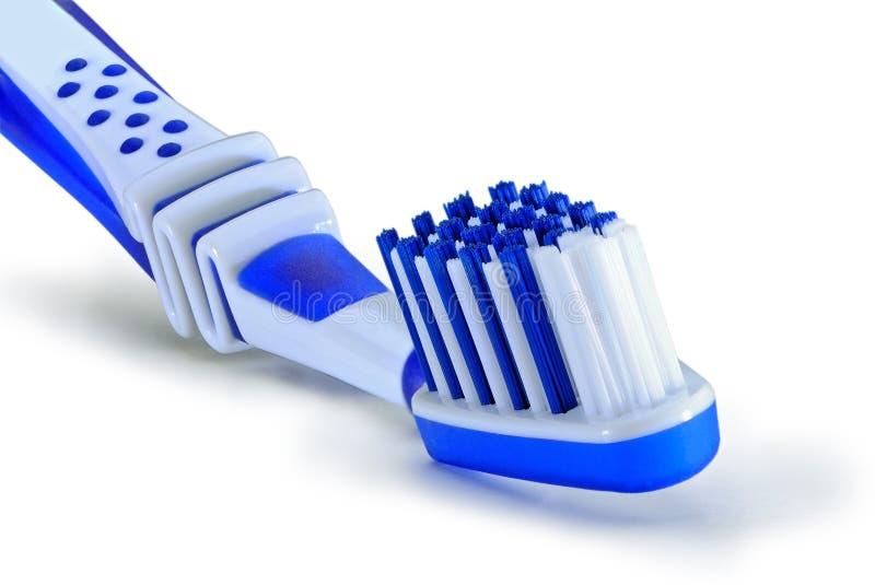 Toothbrush blu isolato su priorità bassa bianca immagine stock libera da diritti
