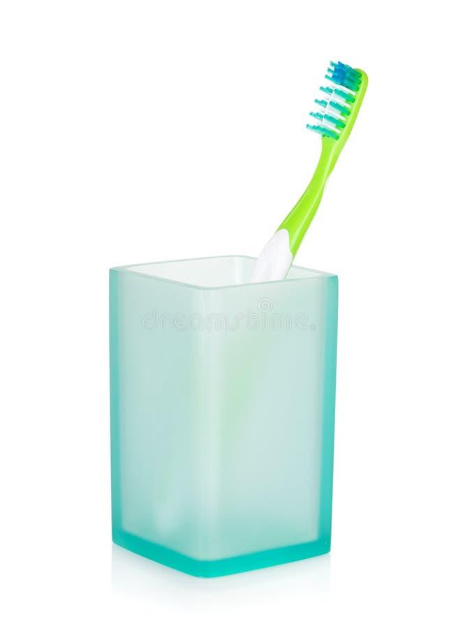Toothbrush em um vidro foto de stock