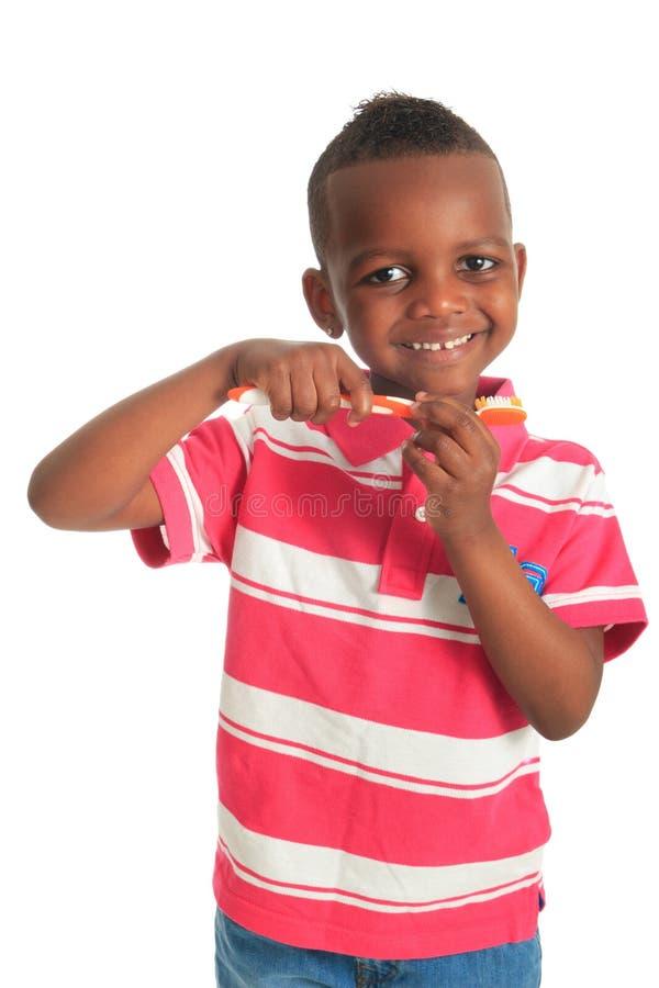 Toothbrush nero del bambino dell'afroamericano immagine stock